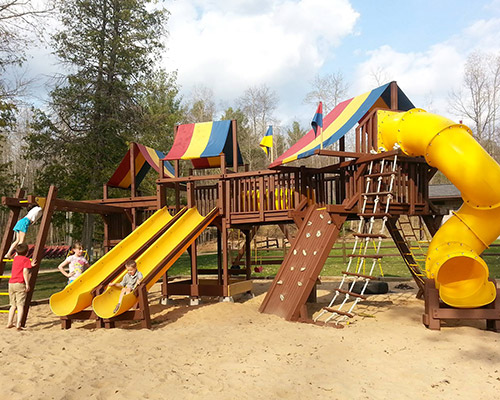 Our youngest guests enjoy hours of fun on our Rainbow Play System.